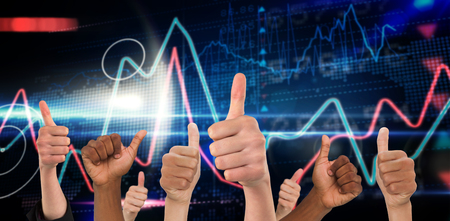 winning stock: Hands showing thumbs up against stocks and shares on black background Stock Photo