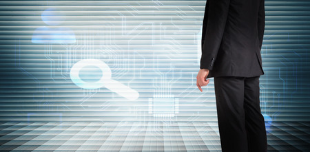 shutters: Businessman standing against grey shutters