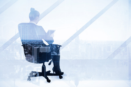 swivel chair: Businesswoman sitting on swivel chair with tablet against high angle view of city skyline