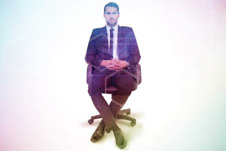 stern: Stern businessman sitting on an office chair  against server room with towers