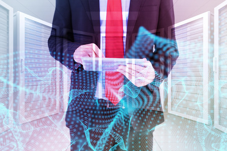 scrolling: Businessman scrolling on his digital tablet against server room