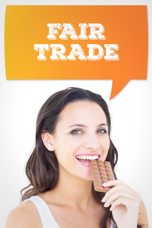 munching: Pretty brunette eating bar of chocolate against white background with vignette