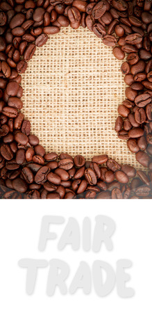 indent: Fair Trade graphic against coffee beans with speech bubble indent for copy space Stock Photo