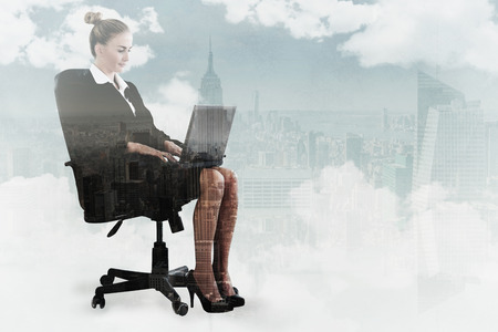 swivel: Businesswoman sitting on swivel chair with laptop against new york