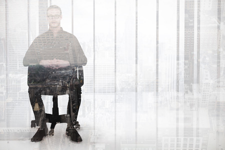 stern: Stern businessman sitting on an office chair against new york Stock Photo