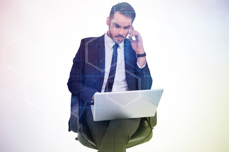 phoning: Businessman using laptop while phoning against digitally generated server room with towers