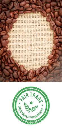 indent: Fair Trade graphic against coffee beans with oval indent for copy space Stock Photo