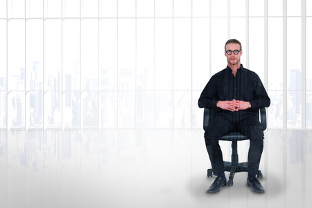 stern: Stern businessman sitting on an office chair against room with large window looking on city