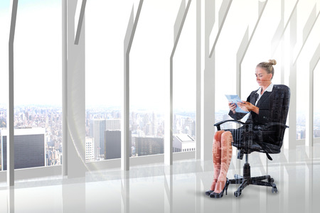 swivel chair: Businesswoman sitting on swivel chair with tablet against high angle view of city