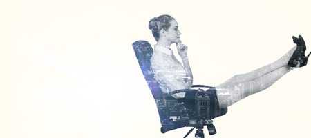 swivel: Businesswoman sitting on swivel chair with feet up against new york