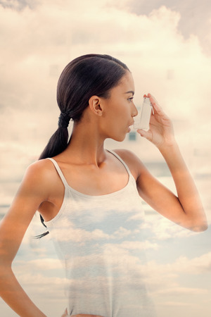 atomizer: Sky  against beautiful model using her asthma atomizer