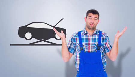 i dont know: Confused handyman giving I dont know gesture against grey vignette Stock Photo
