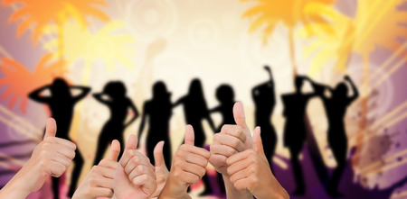 computer dancing: Hands giving thumbs up against digitally generated nightlife background with people dancing Stock Photo