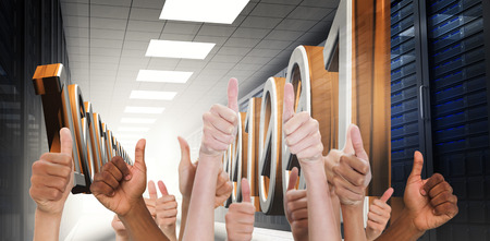 up code: Hands showing thumbs up against 3d binary code in data center hallway
