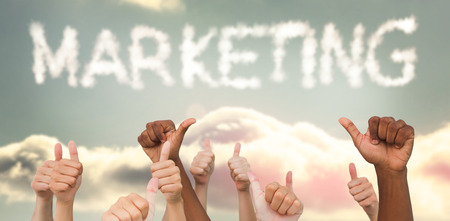 and spelling: Hands giving thumbs up  against clouds spelling out marketing