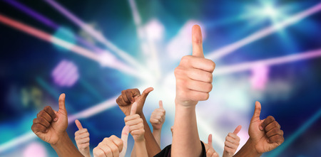 laser lights: Hands showing thumbs up against digitally generated laser lights background Stock Photo