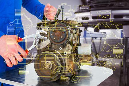 car engine: Male mechanic repairing car engine against auto repair shop