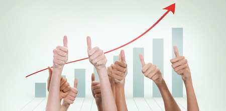 multiple targets: Thumbs raised and hands up  against blue bar chart with red arrow Stock Photo