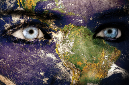 face to face: Earth overlay on face Stock Photo