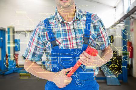 fontanero: Imagen recortada de fontanero que sostiene la llave inglesa contra estaciones de trabajo vac�os