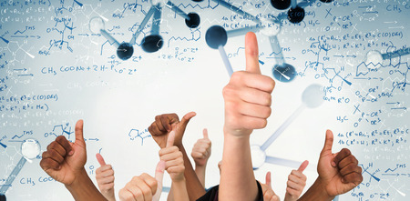 genes: Hands showing thumbs up against notes of biotechnology and genes Stock Photo