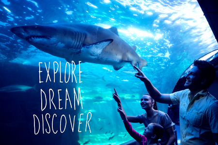 discover: explore, dream, discover against happy family looking at tank