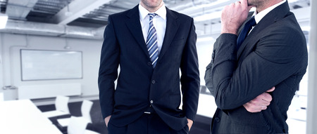 frowning: Frowning businessman thinking  against classroom Stock Photo