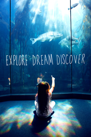 discover: explore, dream, discover against little girl looking at fish tank