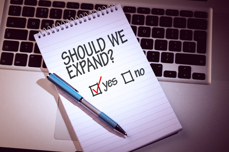 yes no: yes no against notepad on laptop
