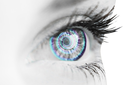 hypnotize: Close up of female blue eye against spiral Stock Photo
