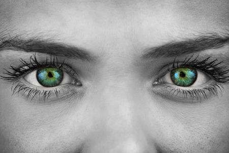 woman eyeball: Blue eyes on grey face against spiral Stock Photo