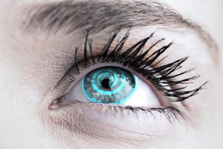 hypnotize: Blue eye against spiral