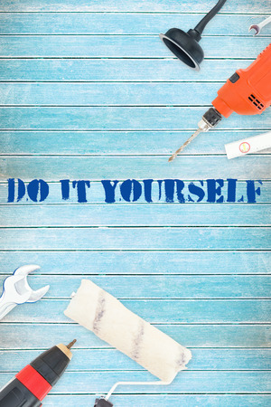 The word do it yourself against tools on wooden background