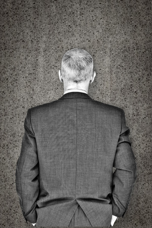 fourties: Businessman against grey background Stock Photo
