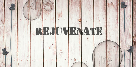 rejuvenate: The word rejuvenate  against wooden background with plugs