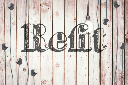 refit: The word refit against light bulb on wooden background Stock Photo