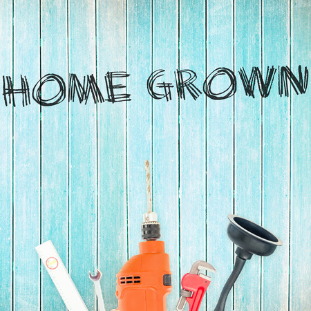 home grown: The word home grown against tools on wooden background Stock Photo