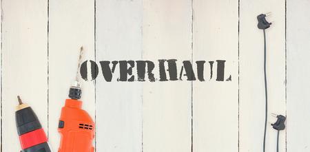 overhaul: The word overhaul against diy tools on wooden background