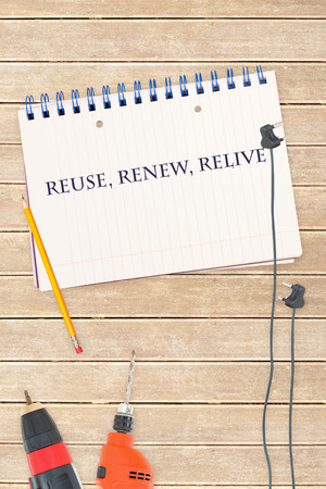 relive: The word reuse, renew, relive against tools and notepad on wooden background