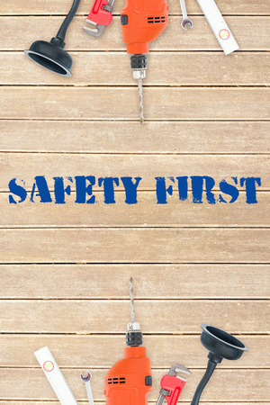 safety first: The word safety first against tools on wooden background Stock Photo