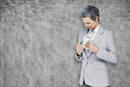 taking a wife: Businesswoman taking bribe against grey background