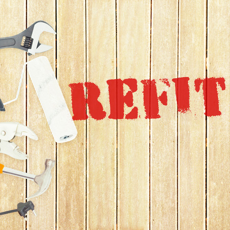refit: The word refit against tools on wooden background Stock Photo
