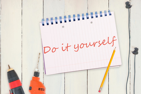 do it yourself: The word do it yourself against tools and tablet on wooden background Stock Photo