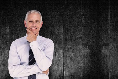 mature business man: Businessman thinking against black background