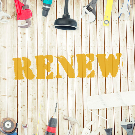 renew: The word renew against tools on wooden background