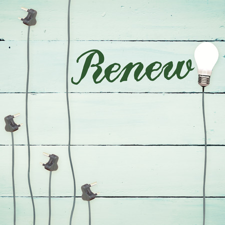 to renew: The word renew against light bulbs on wooden background