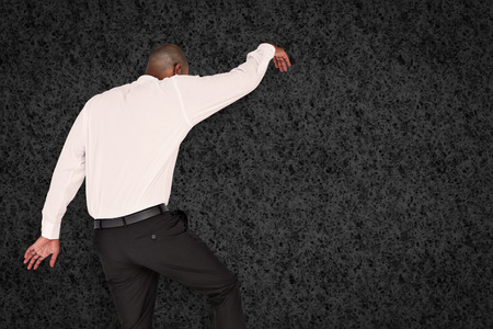 stepping on: Businessman stepping against grey background