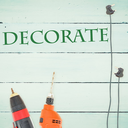 decorate: The word decorate  against tools on wooden background