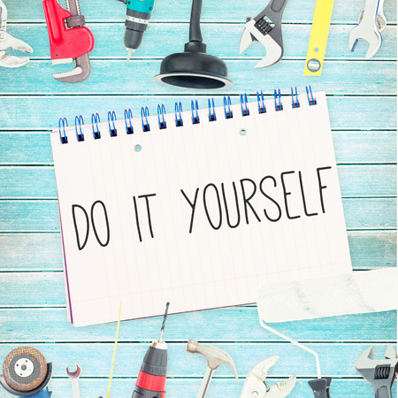 yourself: The word do it yourself against tools and notepad on wooden background Stock Photo