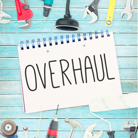 overhaul: The word overhaul against tools and notepad on wooden background Stock Photo